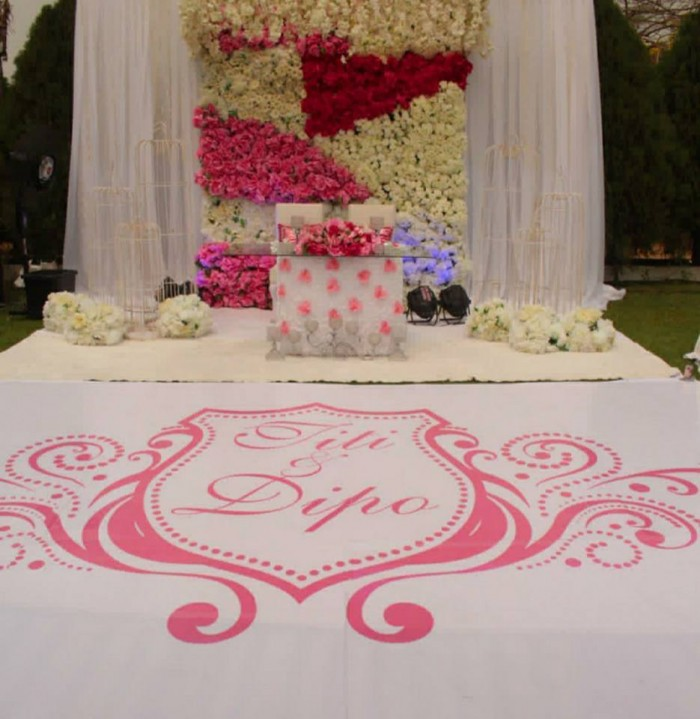 Simple wedding high table decorations by Enrova Events