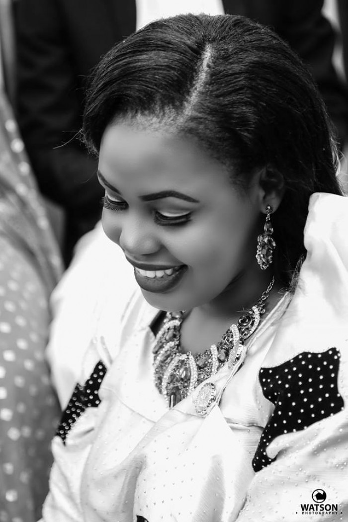 A Black & White photo of a bride at a customary wedding powered by Watson Photography
