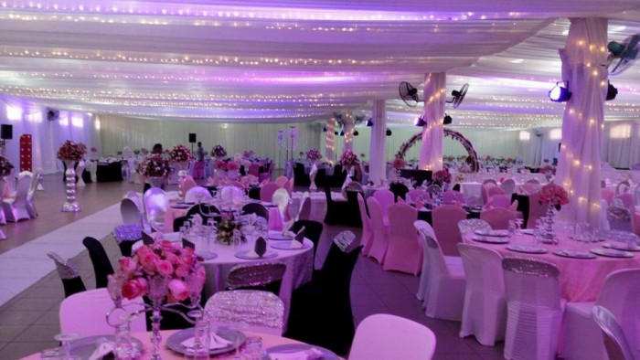 Indoor venue wedding decorations by Mugagga Events