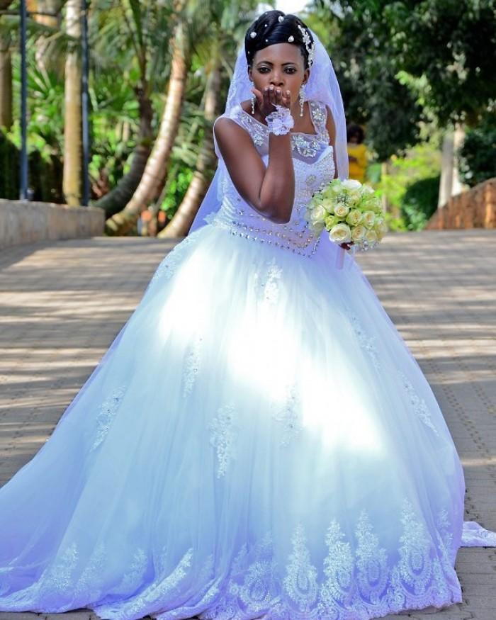 A elegant bride at wedding photo shoot at the Commonwealth Resort Munyonyo