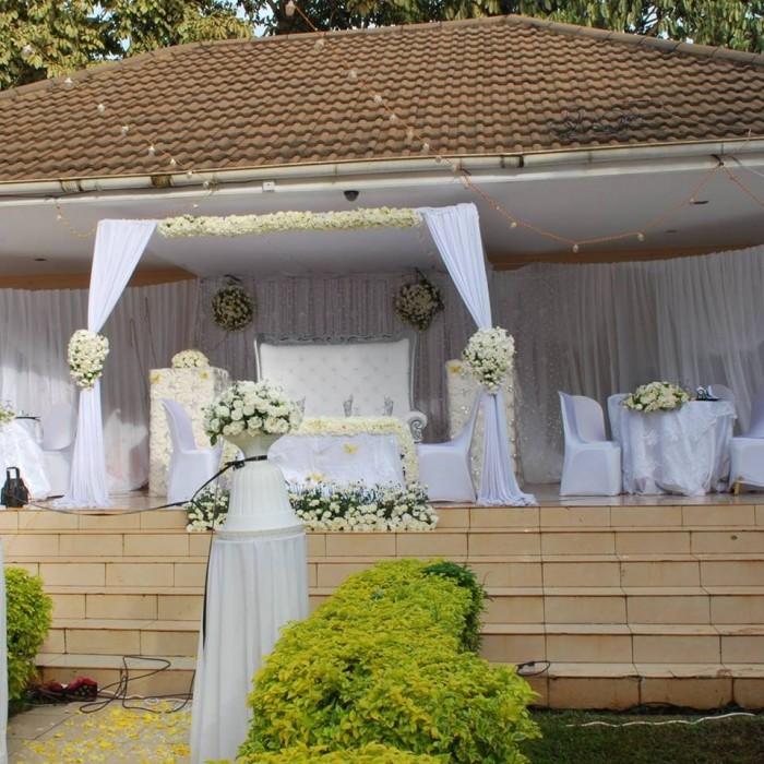 High table wedding decorations at Emerald Hotel Kampala
