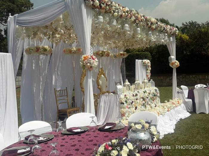 Jeremy & Fiona's plum and silver wedding decor at All sisters gardens Sonde
