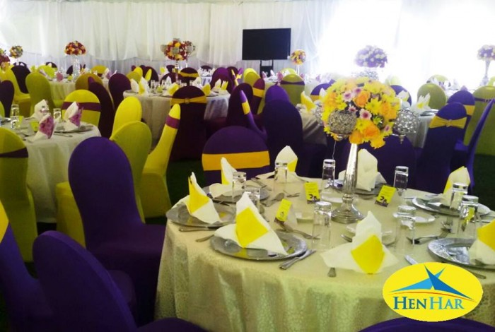 Purple and yellow themed decorations by Henhar Service