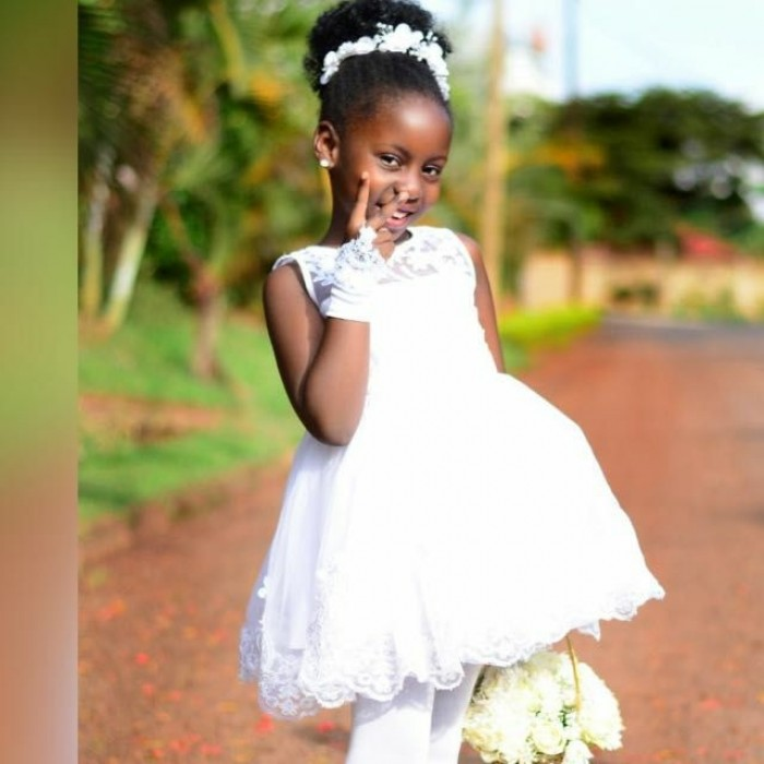 Ugandan flower girl dressed by Peponi Clothings