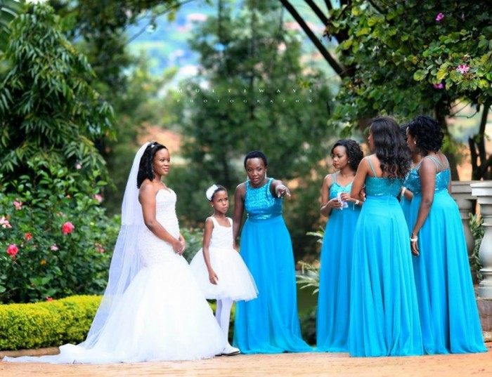 A beautiful bride with her entourage during a wedding photo shoot with MultiWays Photography