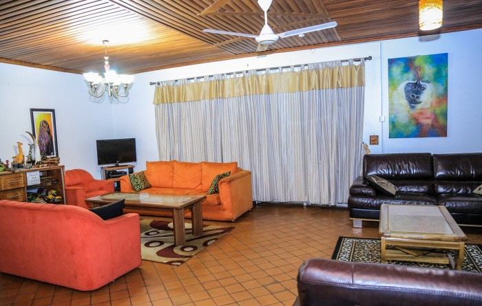 The common living room at Adonai Guesthouse in Muyenga, Kampala