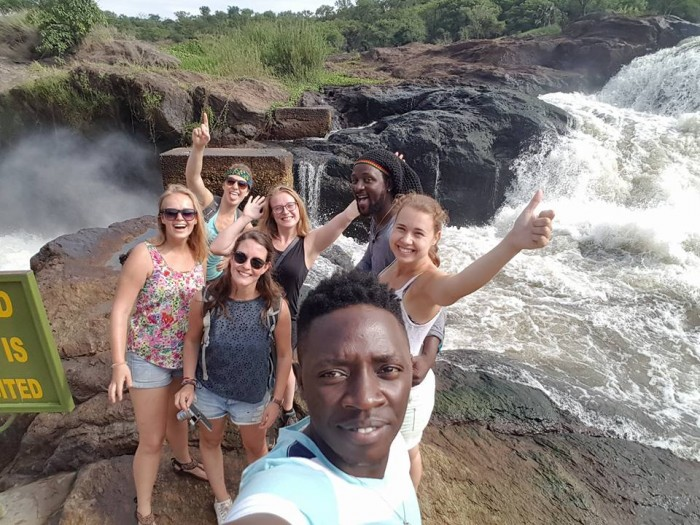 Tourist cheer in excitement during their trip to the Pearl of Africa