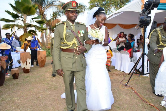 Mr and Mrs Lusiba walk in at their wedding reception amidst performances by Nyange Cultural Performers