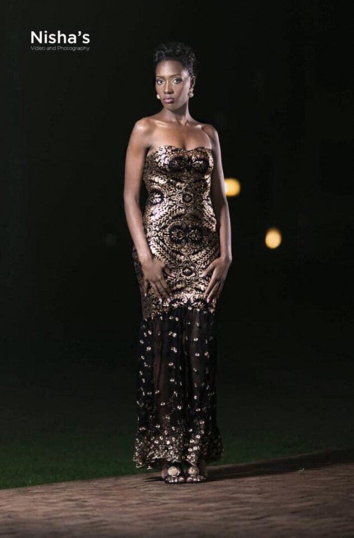 A strapless sequined black dress from  Nisha's Bridal
