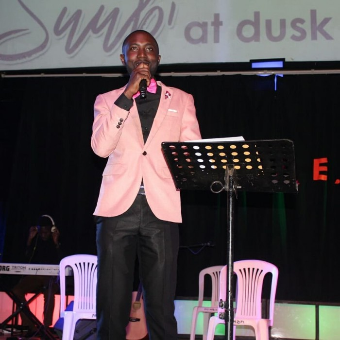 "Moses emcee at ""Suubi At Dusk"", a fundraising dinner"
