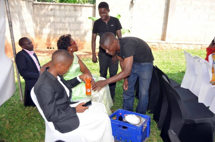Semau Drinks serve guest at Patience Kobusingye's introduction with Katamba