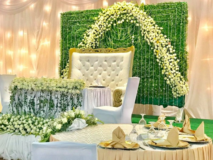 Gold and White themed wedding decorations at Royal Suites by Spice Decorators