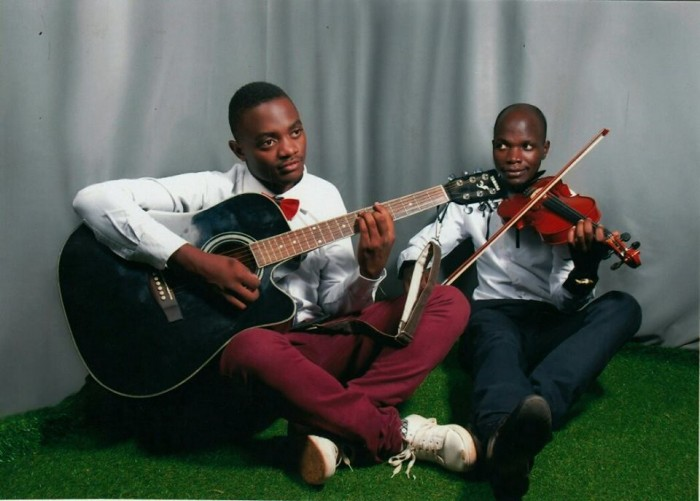 Lead violinist Allan Watson Waswa and lead guitarist in Acoustic, solo and Bass Tayebwa David