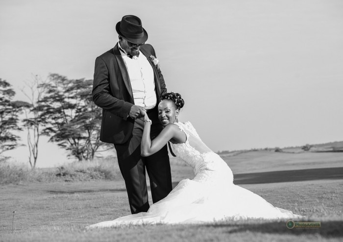 A bride and groom at a wedding photo shoot by Photo Artistik