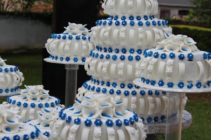 Beautiful white and blue wedding cake at Paya Gardens Nakulabye