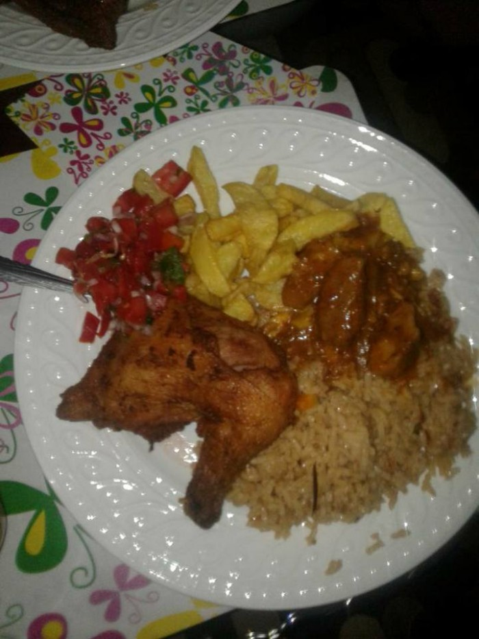 Chicken, rice & chips prepared by Tasty Planet Catering Services