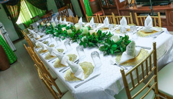 Gold, white and green inspired decorations by Lega Events