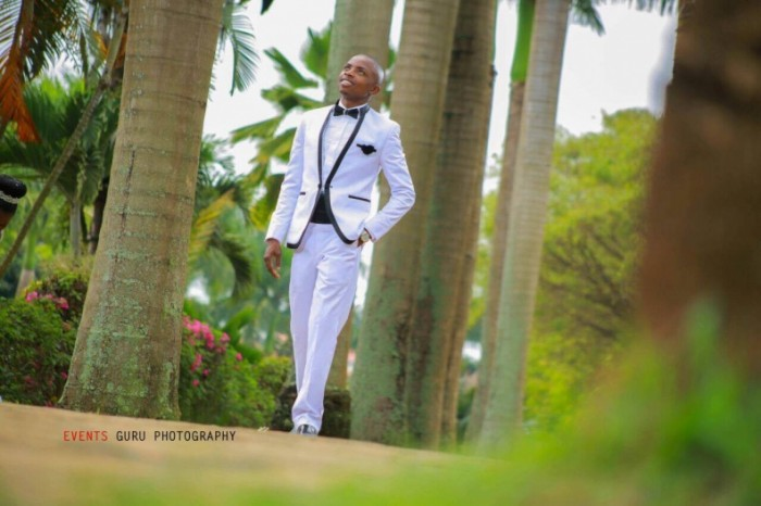 Bod in a white suit on his wedding day as captured by Events Guru Photography