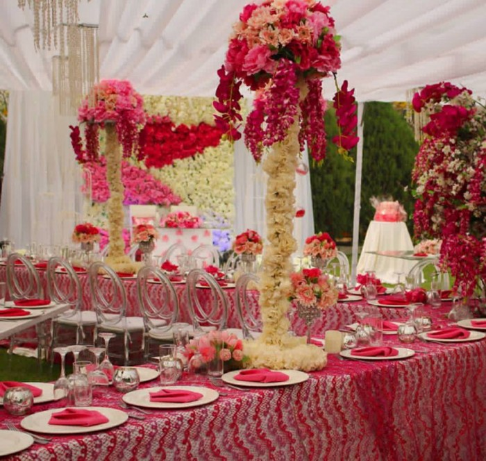 Red inspired wedding decorations with chiavari chairs