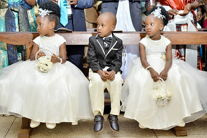 A pair of flower girls and a page boy at a wedding