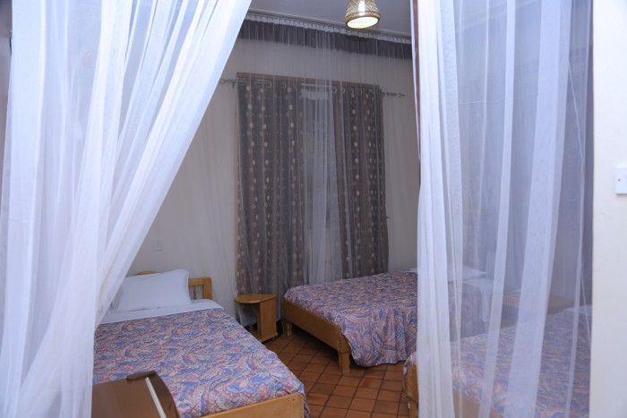 A standard triple room at Adonai Guesthouse in Muyenga
