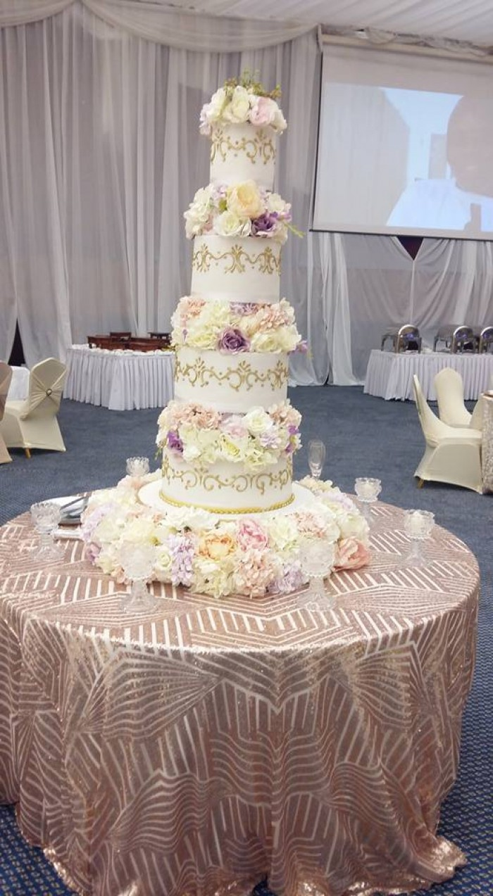 A five tier wedding cakes by Sarahs Cakes