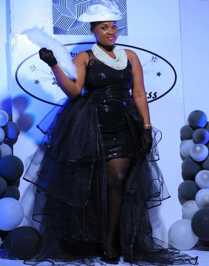 Suzan Kirabo in a tailored outfit at SUKI's 10th Anniversary