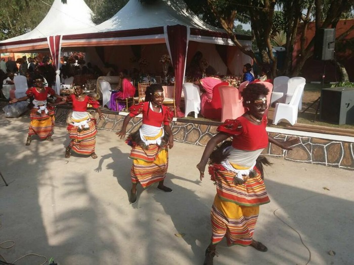 Ladies of the Nyange Cultural Performers group dance in excitement at Regina's introduction