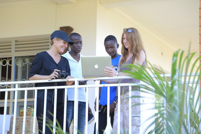 Guests having a light moment at the balcony of Adonai Guesthouse in Muyenga