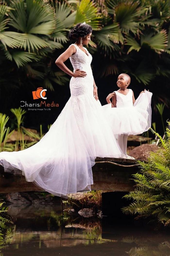 A bride and her flower girl, wedding photo shoot at Speke Resort Munyonyo