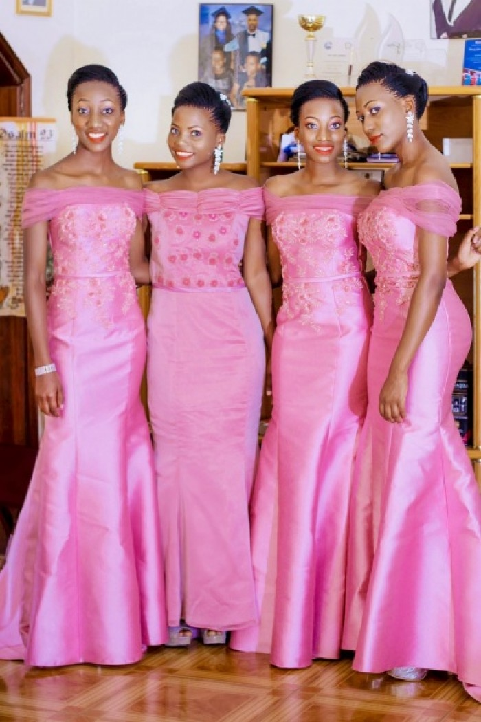 Gorgeous bridesmaids clad in off shoulder pink dresses, photo by Agapix Photography