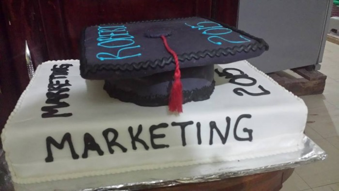 A graduation cake baked by New Day Bakery & Catering Services