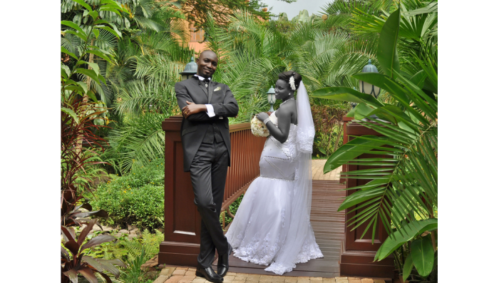 A bride & groom during a wedding photo shoot by Dream Occasions Ug at Serena Hotel, Kampala