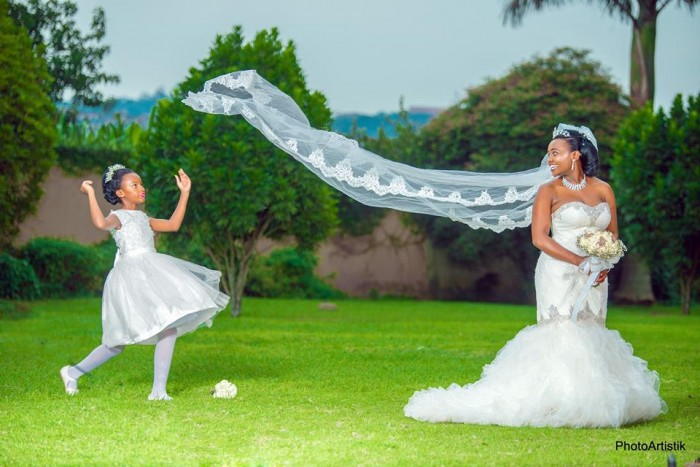 Daphine and her flower girl during a wedding photo shoot with Photo Artistik