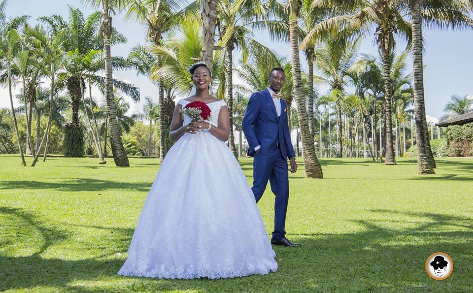 A bride and groom at wedding photo shoot with Ken's shot Photography at Munyonyo