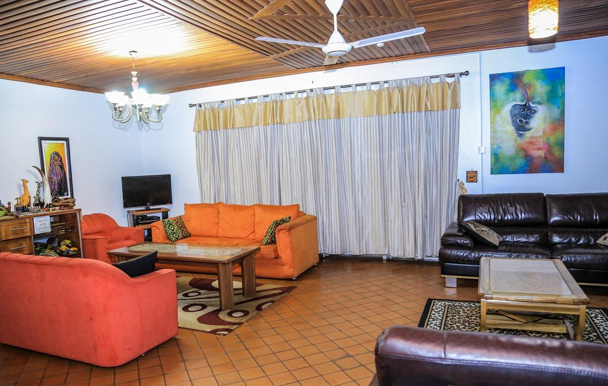 The common living room at Adonai Guesthouse in Muyenga, Kampala