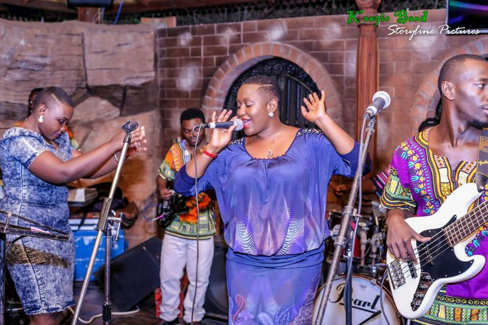 Angela Kalule performing on stage with the K'angie Band