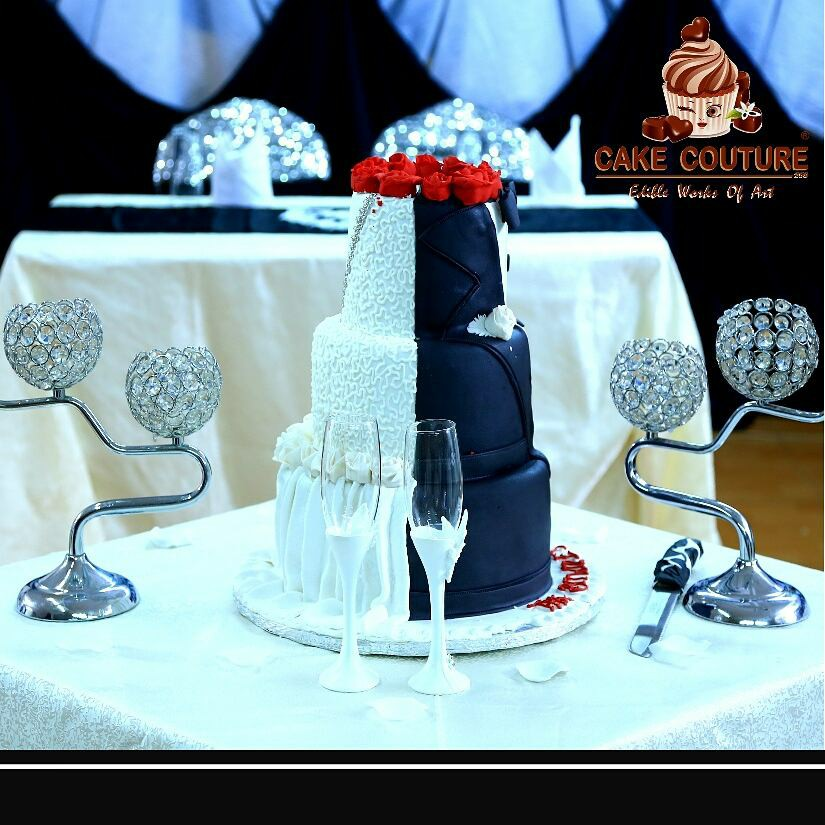 A black & white cake with red flowers by Cake Couture 256