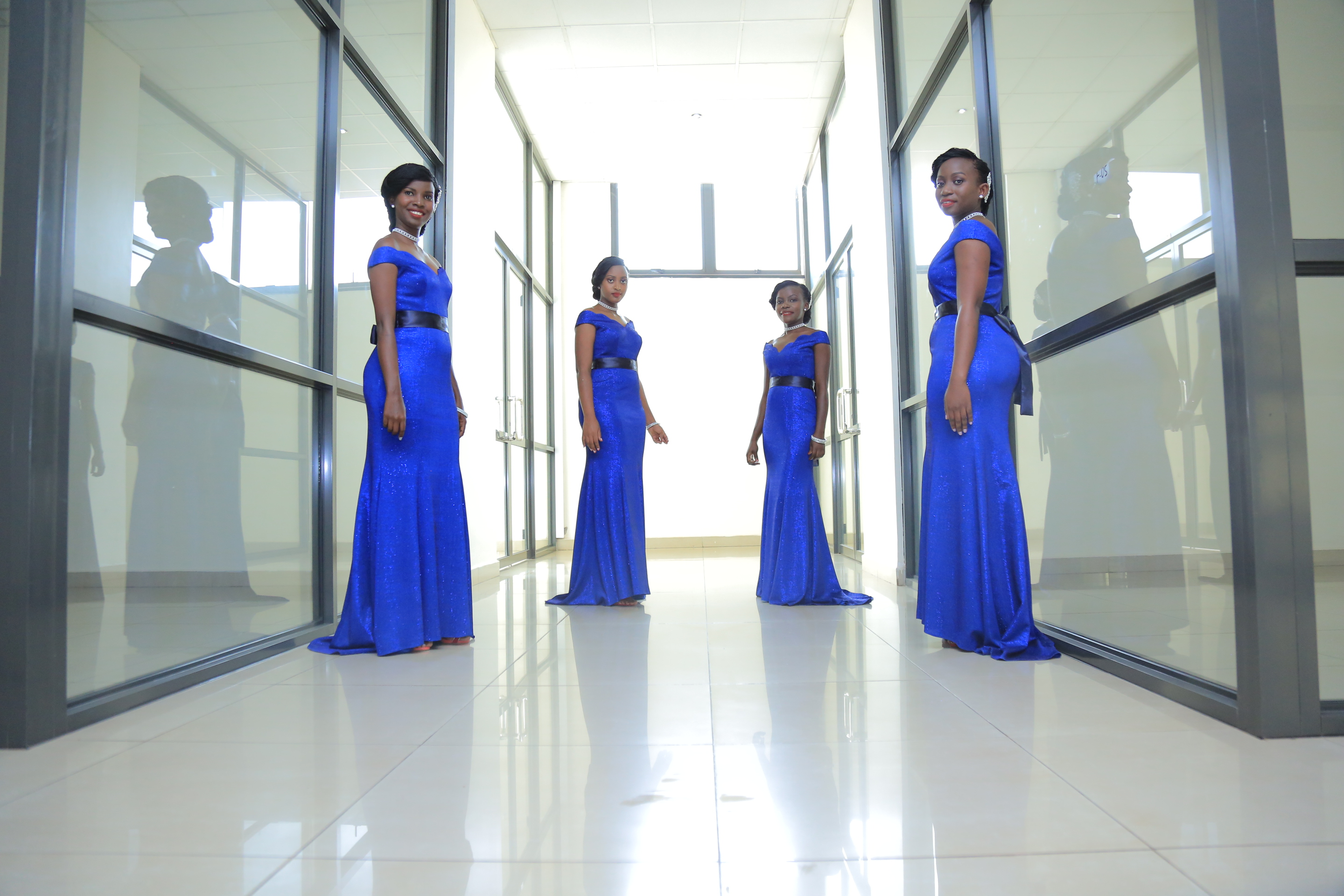 Brenda's bridesmaids clad in blue dresses, shots by Alexander Photography