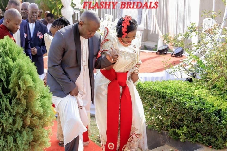 Barbara's Kwanjula Bridal Wear: Gold and Red Gomesi