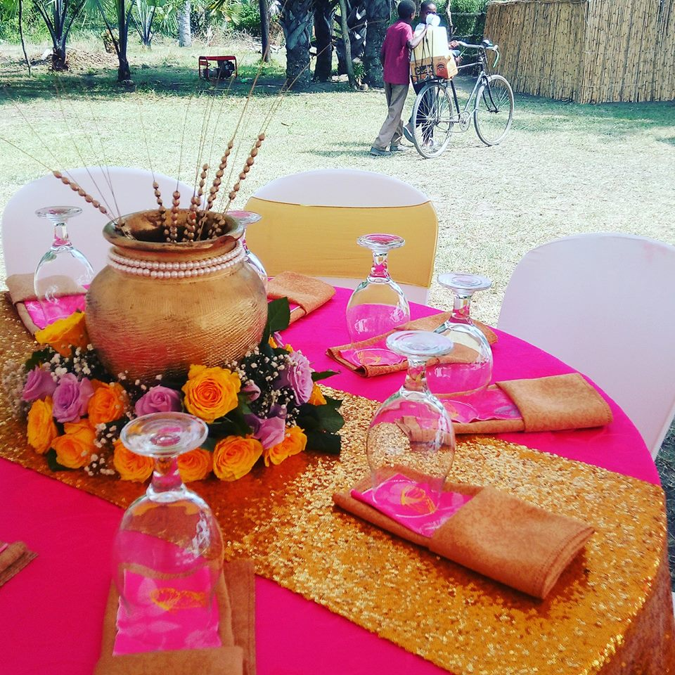 Gold and pink introduction ceremony decorations in Fort Portal by PTW & Events