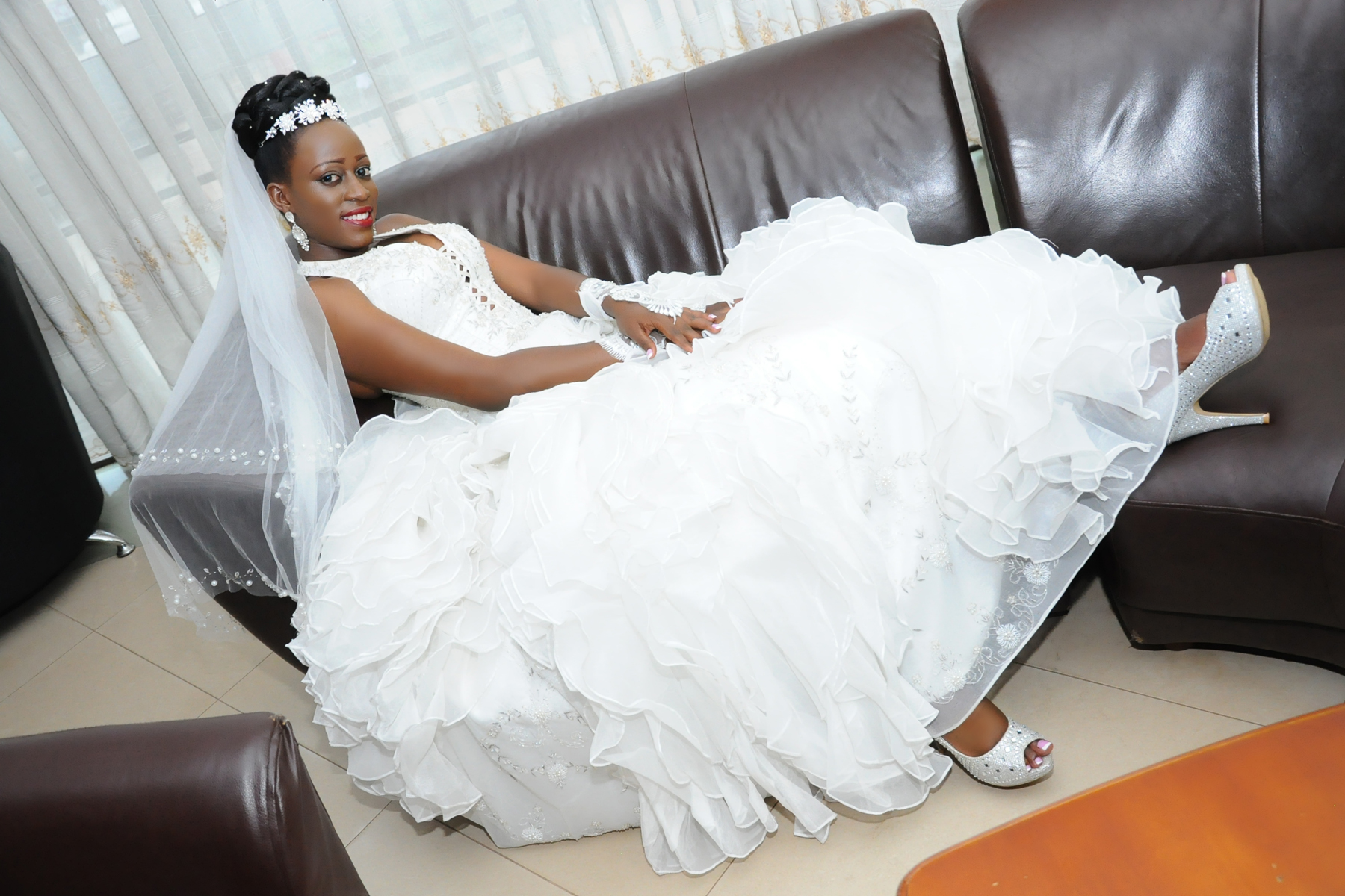 Doreen posing for a photo on her wedding day