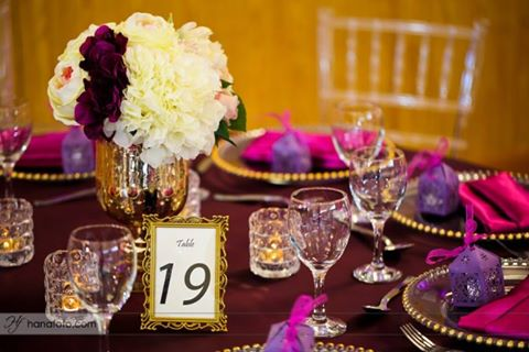 Beautiful purple and gold inspired event decorations by Mugagga Events