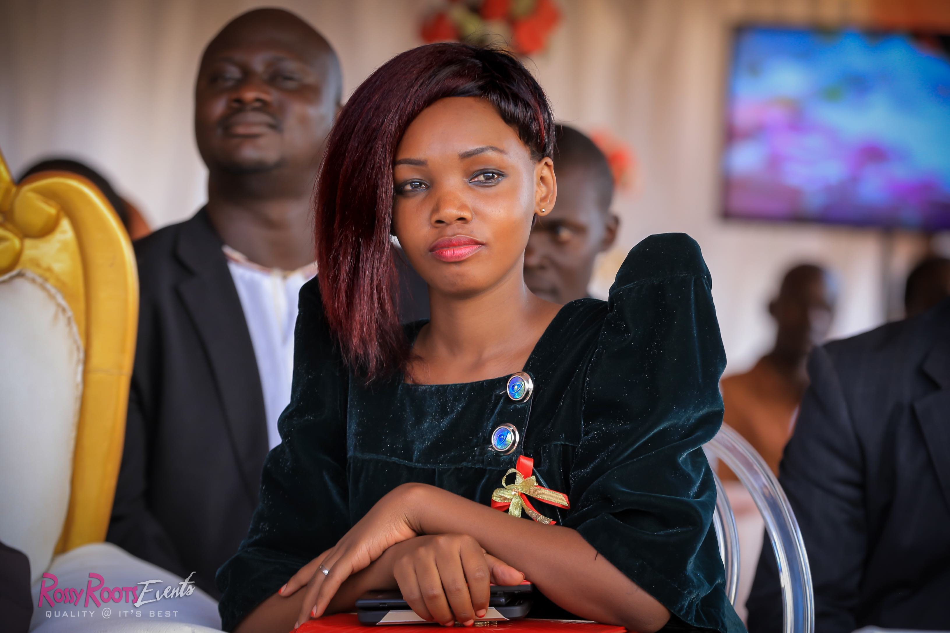 A guest clad in a black velvet gomesi at Violet and Charles' introduction, shots by Rossy Roots Photography